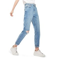 "- ""These days, comfort and versatility are the common denominators for literally everything in my closet, these jeans included. Since they have a super-high, flattering waist and a relaxed fit, I wear them wherever and whenever I can (even when heels are required).""—Angela Melero, Managing EditorTopshop Ripped Mom Jeans in Mid Denim, $75"