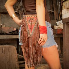 If only I bought leather, this would be mine ... The Rock Star RED Reversible Leather Fringe Cut Cuff - Deliciously Simple Yet Undeniably Boho and Everday Wearable. $32.00, via Etsy.