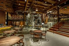 Starbucks opened the Starbucks Reserve Roastery and Tasting Room last week in the Capitol Hill neighborhood of Seattle. Starbucks Shop, Starbucks Reserve, Starbucks Crafts, Starbucks Roastery Seattle, Starbucks Seattle, Wonka Chocolate Factory, Wonka Factory, Pub Design, Architecture