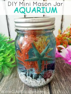 DIY Mini Mason Jar Aquariums are perfect for ocean themed parties or beach weddings. Such a fun craft for kids too!: