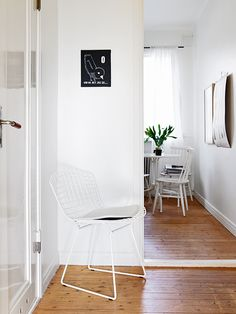 White hallway with peek into the dining area