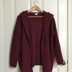 Maroon hooded open knit cardigan with pockets Maroon open knit cardigan. Has a hood and pockets. Thick and warm! Perfect for fall/winter. Hardly worn. A few loose threads could be found around sleeves and pockets and front of cardigan like the ones in one of the above photographs, but are rather small and unnoticeable. Merona Sweaters Cardigans