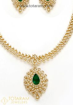 18 Karat Gold Long Diamond Necklace & Drop Earrings Set with Color Stones This Product has Inter Changeable Stones in the Necklace and Earrings Net Gold Weight : 98.700 grams