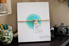 Love Corina Nielsen's packaging - proof you don't have to spend a fortune.  Plain white boxes, stickers with her logo, yarn tying on rep cards around center paper décor.  Go check out her blog posts -- NOW!    http://corinanielsen.com/blog/corina-nielsen-photography-designs-part-1-the-new-look/    http://corinanielsen.com/blog/corina-nielsen-photography-designs-part-2-my-work-spaces/