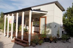 A tiny house with electric bed and modular deck and made largely of recycled wood in Brisbane, Australia. Designed and built by The Tiny House Company. Brisbane Tiny House | Tiny House Swoon