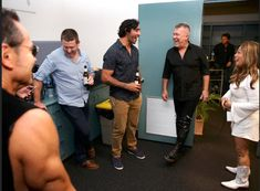 Working class band: Cold Chisel on tour Jimmy and Jane Barnes share a laugh with Johnathan Thurston in the dressing room (normally the North Queensland Cowboys dressing room) before the band's concert at 1300SMILES Stadium, Townsville.  Picture: Gregg Porteous