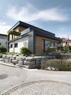 Fertighaus mit Flachdach. Architekturlinie KUBOS von KAMPA.