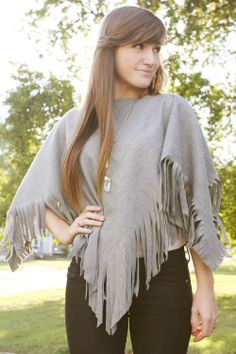 DIY wool poncho! I don't think I would do the fringe, but this is still a sweet little project. No sewing necessary!