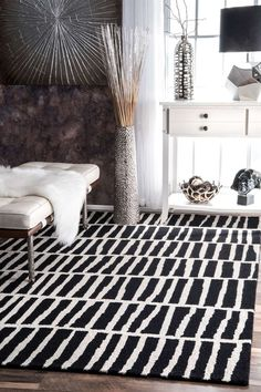 Love how graphic the rug is. Black and White rug. nuLOOM Hand Tufted Lemuel Wool Rug in black + white