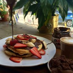 @Regrann from @giulios_cafe -  American Flapjacks with Nutella Strawberries and fried Banana with a side of @morogelato chocolate gelato!