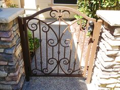 Simple elegance is conveyed by this hand forged wrought iron courtyard entry…