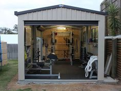 Garage Gym Photos - Inspirations & Ideas Gallery page 1 - This is a nice shed garage gym – power rack, dumbbells, GHD, even a battle rope. very nice gym - Garage House, Home Gym Garage, Diy Home Gym, Gym Room At Home, Basement Gym, Car Garage, Crossfit Garage Gym, Home Gyms, Garage Paint