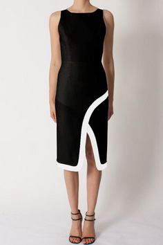 A sharp-seamed dress with contrast color block banding at the back straps and notched hem with hidden back zip and v-neck back. Pair with simple black pumps or black sandals.   Colorblock Sleeveless Dress by Black Halo. Clothing - Dresses - Wedding Wear Clothing - Dresses - Midi Back Bay, Boston, Massachusetts