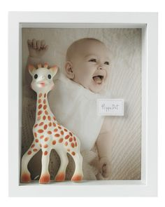 baby photo, favorite toy and 3-d label for a family scrapbox. love this idea. we should do this with our sophie. she's at the bottom of the toy box these days, but used to be the fav.