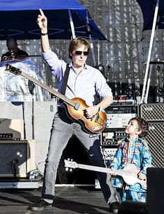 Paul McCartney plays with two year old boy dressed in 'Sgt Pepper '- Uruguay 04/16/2012