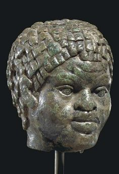 A LATE HELLENISTIC OR ROMAN BRONZE HEAD OF AN AFRICAN CIRCA 1ST CENTURY B.C.-1ST CENTURY A.D.