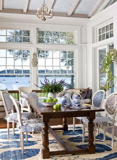 traditional home mag. shingle style: capturing the view This is the breakfast room. Homeowner Eliza Gatfield, who is herself trained as an architect and who did the interior design of her house, had the room's dining chairs covered in eight different fabric patterns, with no two chairs sporting the same combination.