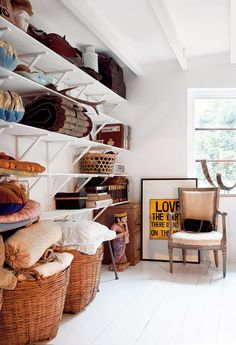 open storage solutions-love the color palette light and open. note the painted wood once again.