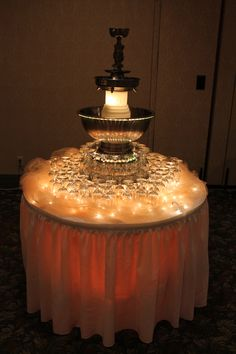 Barn wedding draping cheesecloth and icicle lights for Decor 5 5 litre drink fountain
