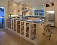 Admirable Bamboo Floor In Kitchen To Show Natural Its Natural Touch : Astounding Bamboo Floor In Kitchen With Brown Kitchen Island And Dark Brown Countertop Combined With Iron Stools And Silver Vent Completed With Silver Refrigerator And Bookshelves Glass Kitchen Cabinet Doors, Maple Kitchen Cabinets, Kitchen Rack, Kitchen Cabinet Storage, Custom Kitchen Cabinets, Glass Cabinets, Island Kitchen, Wood Cabinets, Glass Doors