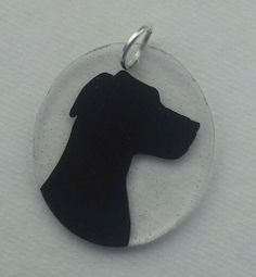 Shrinky Dink Silhouette - this one is clear, but could be white too.  I have plenty of pictures I could turn into silhouettes of my late kitties, to make as a memorial to them.  LOVE THIS IDEA!