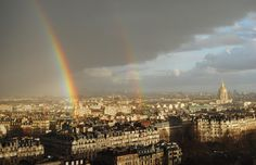 double rainbow over paris from the eiffel tower