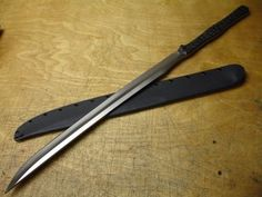 "A long, fast blade, the American Kami Combat Wakizashi. Blade length: 19.75""; Blade thickness: .25""; Overall length: 29.75""; Steel: 5160 high-carbon."