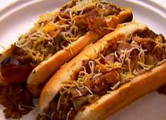 Super Easy Crock Pot Chili Dogs1 pound hot dogs1 large onion, finely chopped2 15 oz. cans chili with beans1 teaspoon chili powder1/4 teaspoon celery salt1/4 pound cheese, shreddedHot dog bunsCombine all ingredients except buns and cheese in crock pot. Stir and cover. Cook on LOW for 4-5 hours. Place cooked hot dog on bun, spoon some chili on top, and add shredded cheese.
