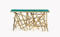 Console table with a base of golden brass tubes and turquoise top plate | Catalogue | Kam Tin Furnitures