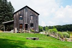 Reclaimed barn wood two-story home with covered patio.