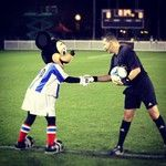 Mickey Mouse and JC Rivero before one of the Disney preseason games in Florida