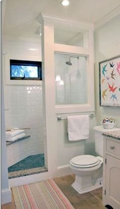 I like the colored tile on the floor and bench top with the white tile for the rest of the shower. Doorless-Walk-In-Shower-Small-Bathroom
