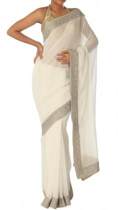 Natural, white Saree with fine zari embroidery by Neeru Kumar.   Indian Designer Neeru Kumar is characterised by traditional techniques, contemporary style sensibilities and an innovative use of colour. Neeru Kumar's label covers a range of products including Shawls, Indian scarves, pret a porter clothing and home furnishings. Strand of Silk (strandofsilk.com) offers a great selection of Indian designer Neeru Kumar including beautiful Indian sarees, kaftans, Indian dresses and Indian tunic…
