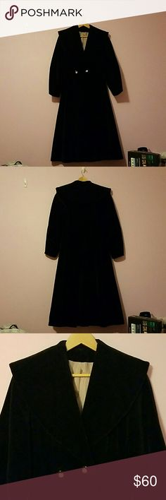 Vintage black velvet coat- tea length Warm velvet coat with puffy long sleeves and draped collar. A bit heavy due to the thick velvet. Like new. I'm a size two and this coat stops at my upper calves...the sleeves were just a little too short since I had long arms. Buttons at the waist and really gives you the appearance of having a small waist/ slender hour glass shape. The bottom/skirt of the coat is pleated. Jackets & Coats