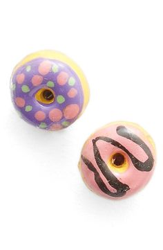 Craving these playful donut earrings with sprinkles and icing that add a sweet touch to any ensemble.