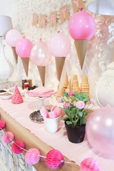 Pink Ice Cream Party Idea - Love this cute set up! Those ice cream cone balloons are awesome! - www.classyclutter.net