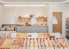 Food - fresh loaves and sugary treats are presented at this renovated bakery in Kiryu, Japan, by architecture studio SNARK