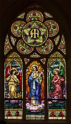 """Stained glass window of Mary says, """"Cause of Our Joy"""", in Immaculate Conception Church of Old Monroe, Missouri"""