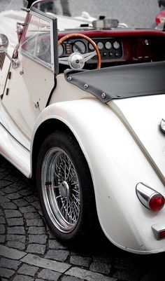 When I was in college, I always wanted a white, convertible bug. I know this isn't a VW bug. My taste has matured.