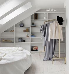 gorgeous brass clothing rack - attic storage dressing room | coco+kelley