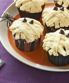 Mummy Cupcakes -- This dessert recipe will be a guest-favorite at your Halloween party--made with chocolate cookies, cake mix and JELL-O Vanilla Flavor Instant Pudding.