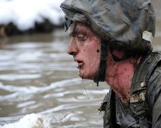 A candidate from Officer Candidate School swims through icy waters during the Quigley in order to complete a combat course at Marine Corps Base Quantico, Virginia, on Jan. 29. The Quigley involves going through obstacles in water and includes a full immersion underwater exercise.