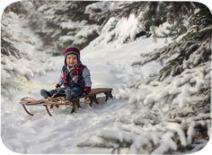 Winter Boy on Sled | Calgary Baby Photography | www.photographybysherri.ca
