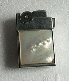 1960`S ASR LADIES LIGHTER MOTHER OF PEARL. Click on the image for more information.