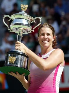 Jan. 26, 2002 file photo shows Jennifer Capriati holding her trophy after defeating Martina Hingis in the women's singles final at the Australian Open tennis tournament in Melbourne, Australia