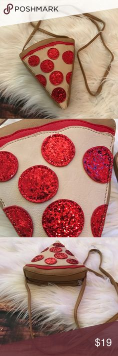 << Pizza Purse  >> Omggggggg I'm obsessed!!  This cute little purse is perfect to supplement your pizza addiction! Equipped with sparkly glitter pepperonis! Zip closure. Boutique Bags Crossbody Bags