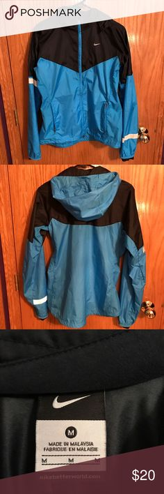 Nike windbreaker jacket! Light weight windbreaker with reflective Nike logo and striping on arms. Comes with detachable hood. Great for fall outdoor workouts! Nike Jackets & Coats