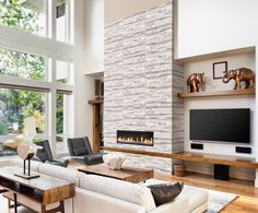 Creating a feature, or accent wall around built-in fireplaces really make them a focal point in the room. Cladding and stone-look tiles are ideal for this to bring the outdoors into your living area. Match this look with wood and metallic accents. Fireplace Facing, Linear Fireplace, Stone Look Tile, Feature Walls, Out Of Africa, African Design, Trendy Home, Cladding, Fireplaces