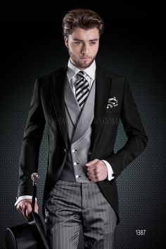 Black tuxedo jacket with grey pants and double-breasted vest SHOP IT @ www.ottavionuccio.com