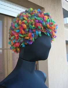 Babukatorium is a crochet artist who does great rainbow colored crochet including this hat.